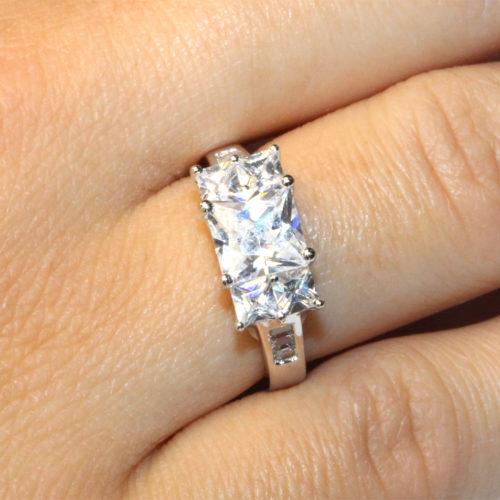 5 Stone Princess Cut Diamond Promise Ring on Hand