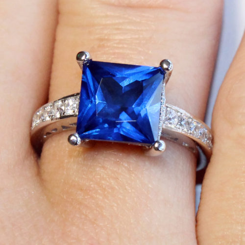 Sapphire Princess Cut Promise Ring on finger