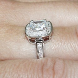 Diamond Halo Promise Ring on Finger