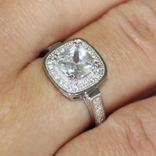 Diamond Halo Promise Ring on Finger 2